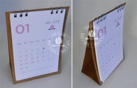 Lembrança calendário 2017 com suporte papel kraft e acabamento em wire-o.